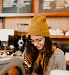 Young woman making barista coffee