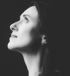 side profile of a woman looking up black and white photo