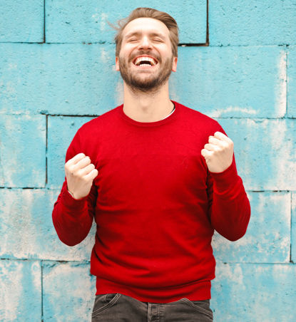 FIAP man in red sweater smiling