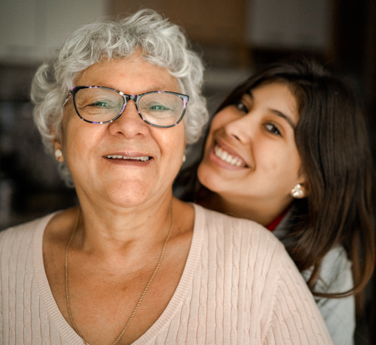 older woman and young woman smiling