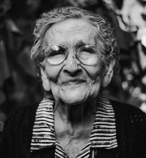Old woman with glasses black and white portrait