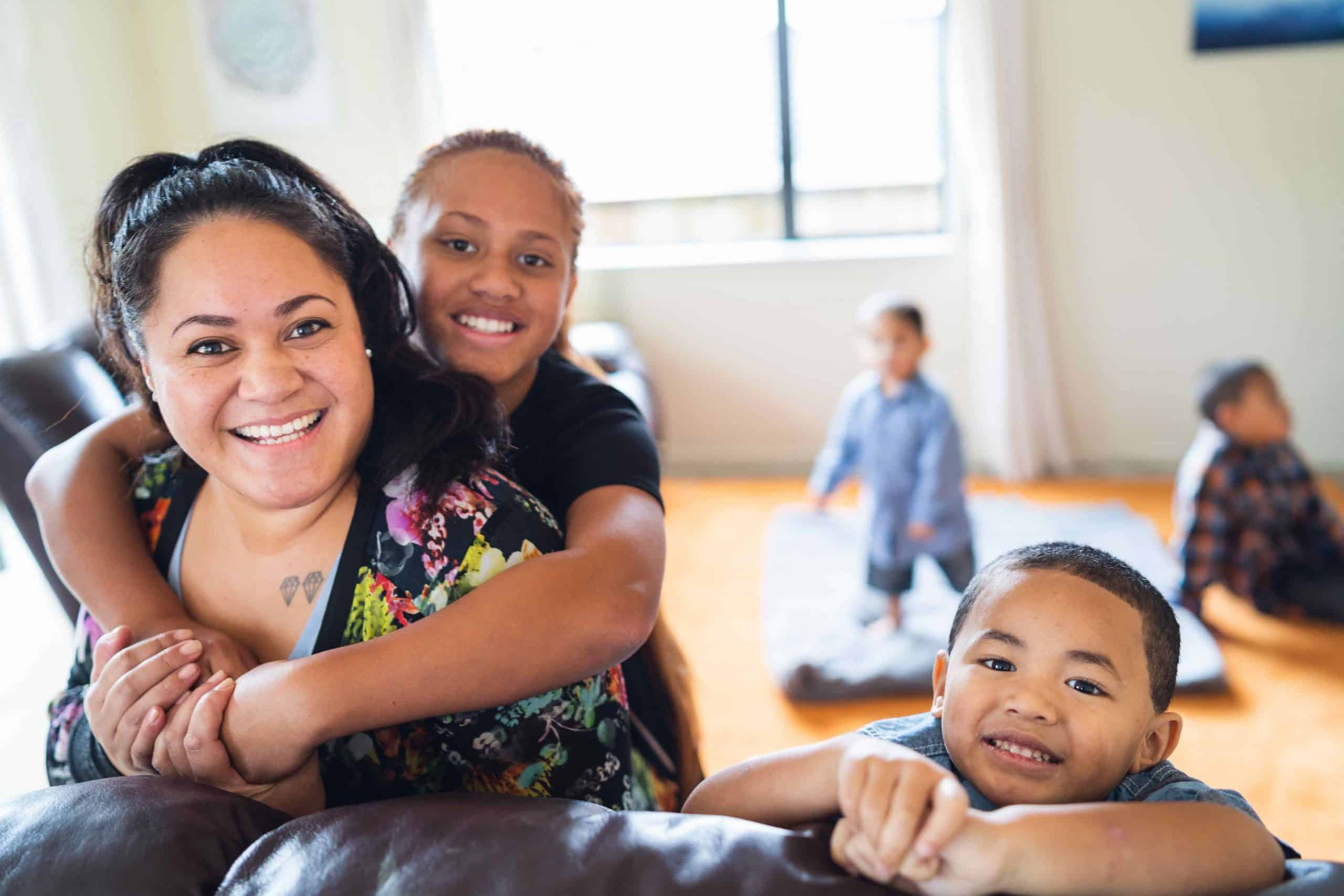 Maori mother with kids at home